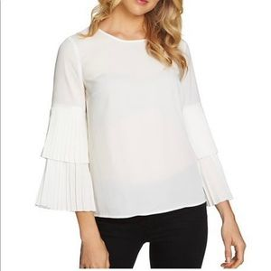 1.State white blouse with pleated bell sleeves